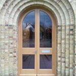 Arched timber door in stunning building