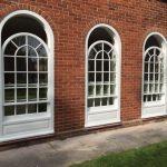 Three timber sliding sash windows curved