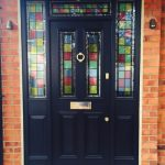 Custom timber entrance door with multicolour stained glass sections