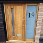 Timber entrance door with sidelight and frosted glass