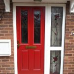 Red entrance door with decorative glass