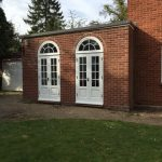 French doors with curved window above