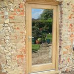 A timber external door with glazed pane