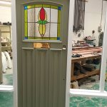 Green timber door in our factory