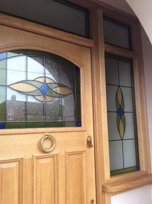Custom oak front door with bespoke stained glass