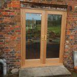 Oak double doors with double glazing