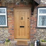 Oak front door with traditional hardware