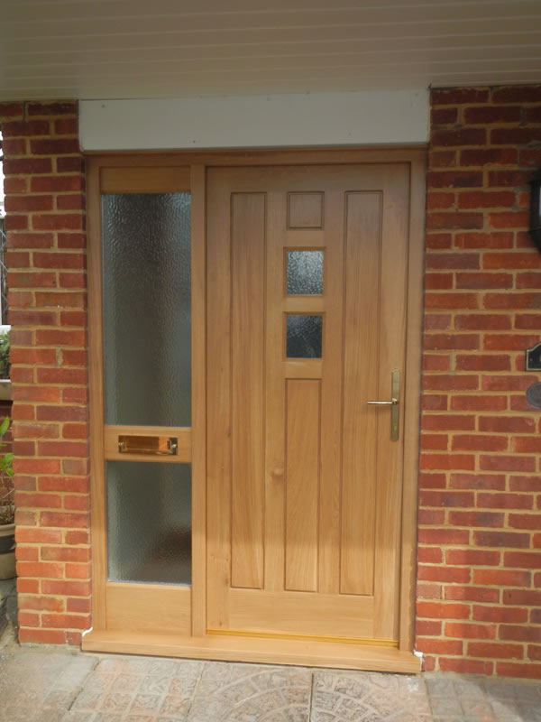 Main door paneling wooden door design puerta de madera for Oak front doors