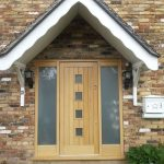 Timber front door with sidelights and glazed sections