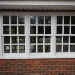 Three sliding sash windows in painted timber