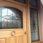 Entrance door in timber with custom stained glass design