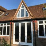 Timber angled windows painted white