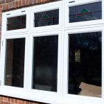 Timber casement windows with lead details and coloured glass pattern