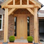 Timber front door with timber beams surrounding