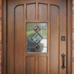 Timber door with custom moulded panel