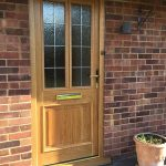 Timber door with lead detail installed