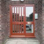 Timber front door with grate style