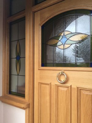 Oak door with custom stained glass