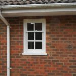 Small wooden sash window painted white