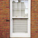 Timber sliding sash window in white