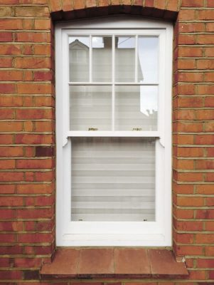 Timber sliding sash window in white