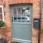 Timber stable door in traditional green