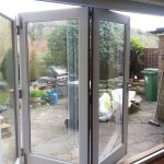 White bifold door in timber