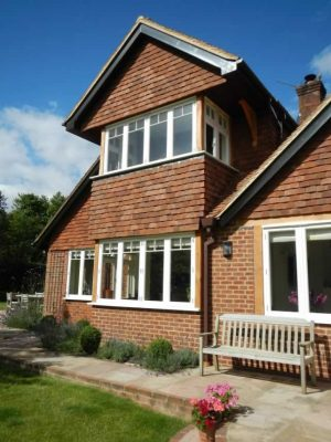 Timber windows painted white on large house
