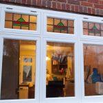 White wooden windows with decorative glazing