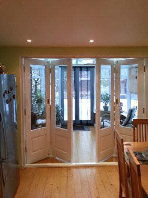 Folding timber bi-fold door painted white