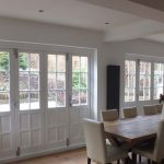 Folding timber doors glazed