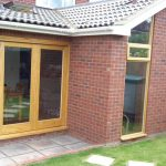 Timber bifolding doors leading onto the patio area