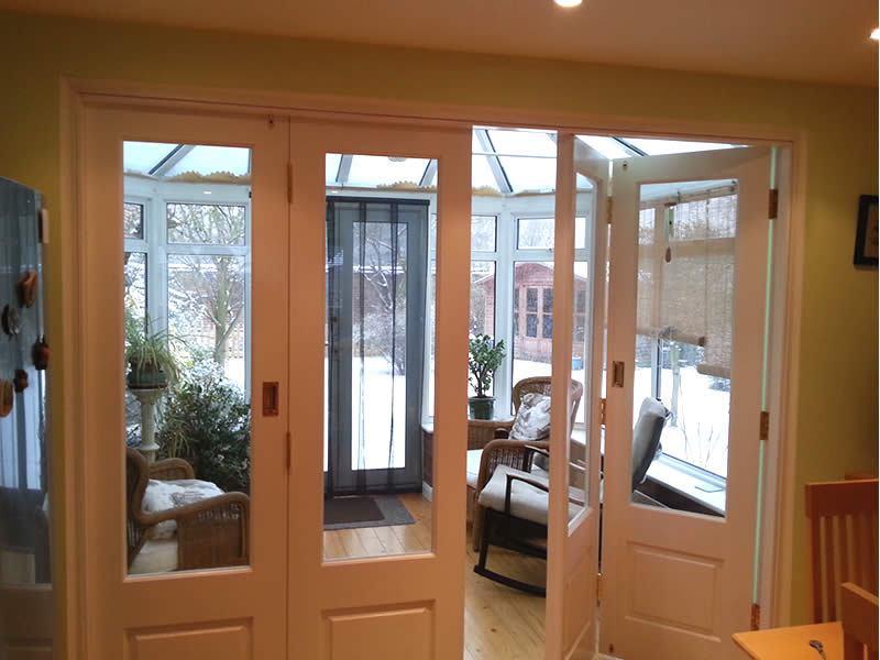 Timber bi-folding door partially open